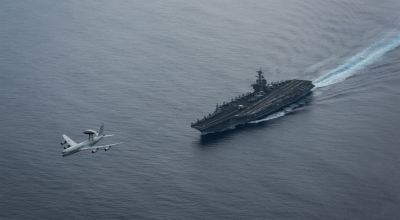 Picture of the Day: Air Force E-3 Flies Over the USS Theodore Roosevelt CVN 71