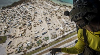 Picture of the Day: Air Force Pararescueman Aboard HH-60G Pave Hawk Surveys Damage by Hurricane Irma