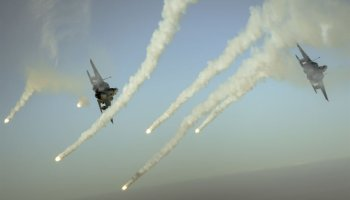 F-15E Strike Eagles fire flares over Iraq Operation Inherent Resolve