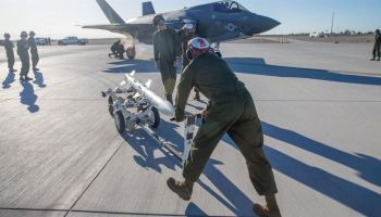 Marine Fighter Attack Squadron 121 load ordnance on a F-35B Lightning II