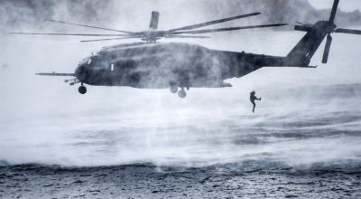 Picture of the Day: Service Member Jumps from Navy MH-53E Sea Dragon Helicopter