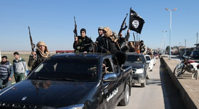 Thousands of ISIS members were secretly allowed to leave Raqqa with weapons and ammo — and the US knew about it