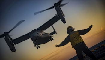 MV-22B Osprey lands on the flight deck of the amphibious assault ship USS Iwo Jima