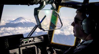 Picture of the Day: Air Force Capt. Kyle Schneider, C-130J Super Hercules Pilot, Flies near Mount Fuji