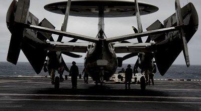 Sailors prepare to move E-2D Hawkeye VAW 120 & Hawkeye Ball