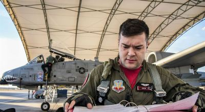 Picture of the Day: Air Force Capt. Haden Fullam 75th Fighter Squadron Pilot Readies His Flight Plan