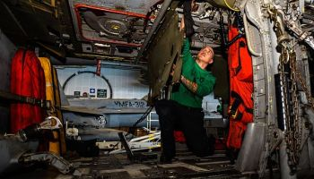 Aviation Structural Mechanic 2nd Class Jared Stagner Works on an MH-60S Sea Hawk