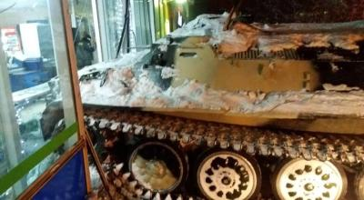 Watch: Russian man steals Armored Personnel Carrier and drives through the wall of local store to grab a bottle of wine