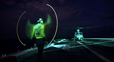 Picture of the Day: Navy Seaman Ryan Sharland Signals a UH-1Y Venom Helicopter on the USS San Diego