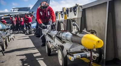 Picture of the Day: Seaman Charles Joseph Positions a Missile on the Flight Deck of the USS Carl Vinson