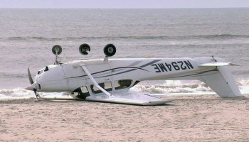 Watch: Small Plane on Training Flight Lands on Beach and Flips Over