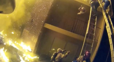 Watch: Firefighters catch children thrown from the 3rd floor of Atlanta apartment building