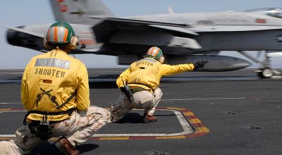 "Watch: Aircraft Carrier Flight Deck ""Shooter"" – What They Do (and More!)"