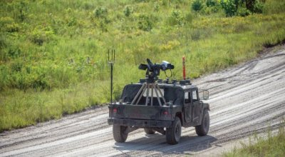 Here's the Army's new drone Humvee with self targeting, electrically fed 7.62 machine gun