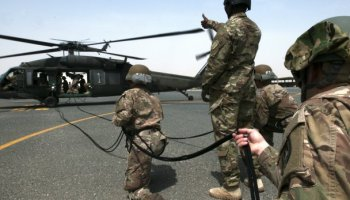 Air Assault trainees rappel from UH-60 Black Hawk helicopter