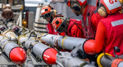 Picture of the Day: US Navy 'Red Shirt' Ordnancemen Operating on the USS Harry S. Truman