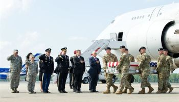 U.S. Army carry team transfers the remains of Army Spc. Christopher Michael Harris