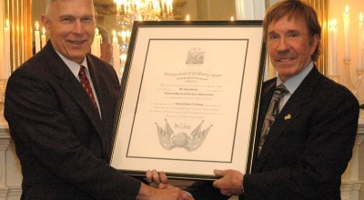 General James Conway, 34th Commandant of the Marine Corps, and Mr. Chuck Norris pose for a photo with the Honorary Marine citation presented to Norris during a dinner held in his honor on March 28, 2007. The dinner was held at the Home of the Commandant's located at Marine Barracks Washington, D.C. | Official USMC Photo by Sgt. Christopher M. Tirado