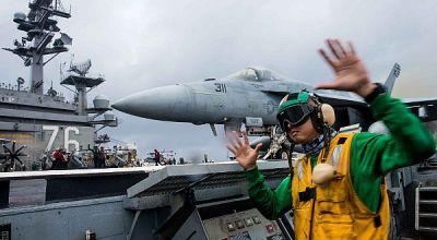 Picture of the Day: Aviation Boatswain's Mate 1st Class Clayton Hudson Signals for Launch of an F/A-18E Super Hornet
