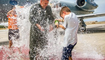 Marine Corps Lt. Col. Mark Angersbach is splashed with water in recognition of his final flight