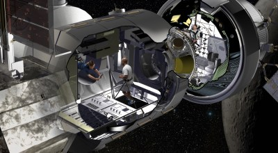Artist rendering of the NextSTEP habitat docked with Orion in cislunar orbit as part of a concept for the Deep Space Gateway. | Lockheed Martin