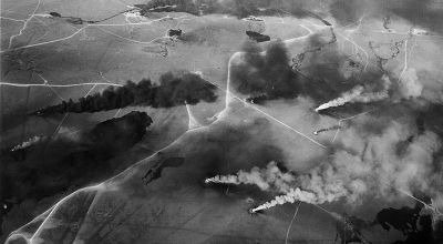 Featured image: An aerial view of Kuwait oil fires set by retreating Iraqi troops in the last days of the Persian Gulf War (late 1990 to early 1991). The resulting inferno emitted large amounts of carbon dioxide and other gases into the atmosphere, while locally the thick smoke blocked sunlight, lowered temperatures, and engulfed the area in a mist of microscopic oil droplets. | National Science Foundation photo by Robert Bumpas