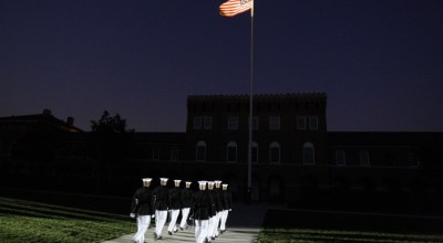 Marines march near the start of the evening parade that President Barack Obama is watching at the Marine Corps Barracks in Washington Friday, July 24, 2009.| AP Photo/Alex Brandon