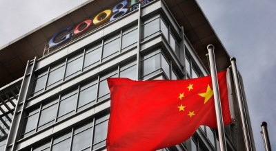 In this March 25, 2010 file photo, a Chinese flag flaps in the wind in front of the Google China headquarters in Beijing. A year after a public spat with Beijing over censorship, Google Inc. says its business with Chinese advertisers is growing even as the Internet giant's share of online searches in China plunges. A major Chinese portal announced last week it would no longer use Google for search, compounding its rapid loss of market share since March last year when it closed its local search engine. | AP Photo/Gemunu Amarasinghe, File