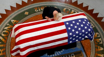 Cindy McCain, wife of Sen. John McCain, R-Ariz. lays her head on casket during a memorial service at the Arizona Capitol on Wednesday, Aug. 29, 2018, in Phoenix. AP Photo/Ross D. Franklin, Pool
