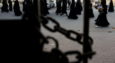 Bahraini protesters are seen through a locked gate as they carry pictures of Saudi Shiite cleric Sheikh Nimr al-Nimr during a demonstration against his execution by Saudi Arabia, Sunday, Jan. 3, 2016, in Daih, Bahrain. Saudi Arabia announced the execution of al-Nimr on Saturday along with 46 others. Al-Nimr was a central figure in protests by Saudi Arabia's Shiite minority until his arrest in 2012, and his execution drew condemnation from Shiites across the region. | AP Photo/Hasan Jamali