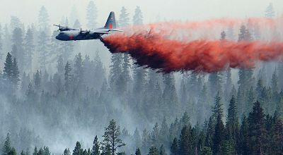 C-130 equipped with a MAFFS system sprays retardant over the Black Crater Fire in Oregon./WikiMedia Commons