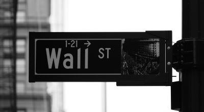 Black and white photo of the street sign for Wall St in New York City | Rick Tap, via Unsplash