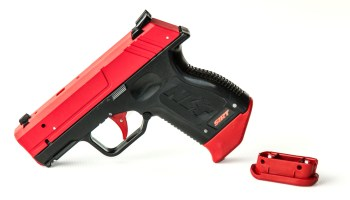 Shot Indicating Resetting Trigger: The Laser Pocket Pistol Trainer