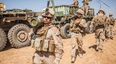 SYRIA - U.S. Marines with the 11th Marine Expeditionary Unit carry 155mm rounds to an M777 Howitzer gun line in preparation for fire missions in northern Syria as part of Combined Joint Task Force - Operation Inherent Resolve, Mar. 21, 2017. (DoD)