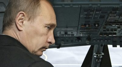 Russian Prime Minister Vladimir Putin seen in a cockpit of Tupolev Tu-214 passenger jet, one of the three jetliners bought by Transaero air company, in St.Petersburg, Monday, Oct. 26, 2009. The Tu-214 is medium to long-range airliner, a development of the Tupolev Tu-204 with higher weight and longer range. (AP Photo/RIA-Novosti, Alexei Nikolsky, Pool).