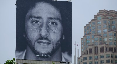 A large billboard showing Colin Kaepernick stands on top of the building housing the Nike store at Union Square Wednesday, Sept. 5, 2018, in San Francisco. An endorsement deal between Nike and Colin Kaepernick prompted a flood of debate Tuesday as sports fans reacted to the apparel giant backing an athlete known mainly for starting a wave of protests among NFL players of police brutality, racial inequality and other social issues. (AP Photo/Eric Risberg)