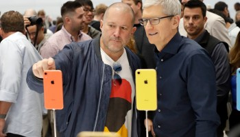 Jonathan Ive, Apple's chief design officer, left, looks at some new iPhone models with CEO Tim Cook during an event to announce new products Wednesday, Sept. 12, 2018, in Cupertino, Calif. (AP Photo/Marcio Jose Sanchez)