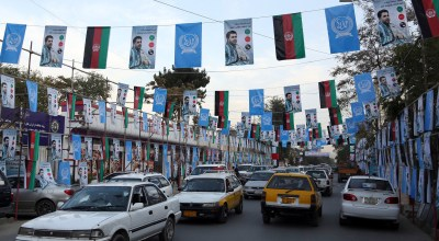 Campaign posters for parliamentary candidate Ahmad Tamim Jurat are displayed over a street, in Kabul, Afghanistan, Sunday, Sept. 30, 2018. Afghan parliamentarian candidates have started their campaigning across the country for the upcoming election scheduled for Oct. 20. (AP Photo/Rahmat Gul)
