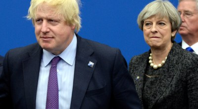 Former British Foreign Secretary Boris Johnson, left, and Britain's Prime Minister Theresa May arrive for a meeting during the NATO summit of heads of state and government, at the NATO headquarters, in Brussels (AP).