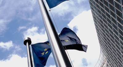 EU flags fly outside the European Parliament/Wikimedia Commons.