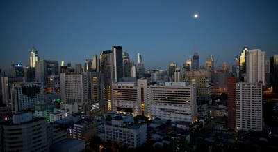 Skyscrapers are illuminated by moonlight at dawn Wednesday, Sept. 26, 2018 in Bangkok, Thailand. Construction of luxury high rise residences is booming in the city, driven partly by strong demand from wealthy Chinese and other foreign investors. (AP Photo/Gemunu Amarasinghe)