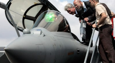 A French air force officer explains the inner workings of the Superjet Rafale M to visitors during the 48th Paris Air Show (AP).