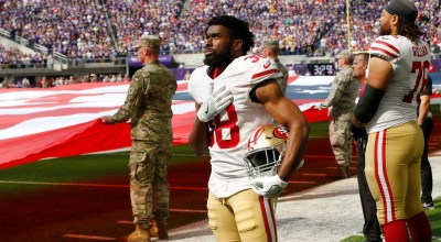 San Francisco 49ers defensive back Antone Exum stands on the field during the national anthem before an NFL football game against the Minnesota Vikings, Sunday, Sept. 9, 2018, in Minneapolis. (AP Photo/Jim Mone)