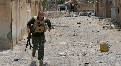 Several U.S. and British volunteer fighters are on the front lines in the decisive battle against IS for the Syrian city of Raqqa. They joined the U.S.-allied militias in Syria for different reasons, some motivated by testimonies of survivors of the unimaginable brutality that IS flaunted in establishing its self-proclaimed caliphate. (AP Photo/Hussein Malla)