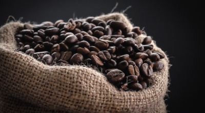 Shallow focus photography of coffee beans in sack/Tina Guina on Unsplash