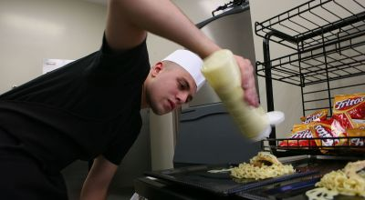 Cpl. Ian J. Sanders, 21, from Mount Pleasant, Mich., food service specialist with the 14 Area chow hall, Food Service Company, Combat Logistics Regiment 17, 1st Marine Logistics Group, prepares his spinach and cheese stuffed chicken and herb seasoned noodles to be judged at the Marine Corps Installations – West Chow Hall of theQuarter competition at Camp Las Flores dinning facility, Feb. 18. Eight teams throughout the west coast competed in the two-day cook-off to represent their chow hall with hopes of taking home the gold. (Wikimedia Commons).