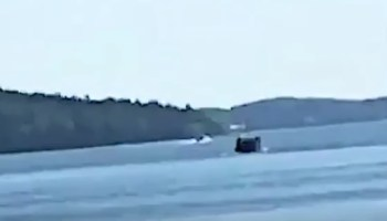 Watch: Kids record cell phone video of unidentified submarine surfacing off the coast of Sweden