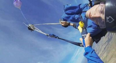 Watch the insane footage of a jump master saving a skydiver that has a seizure mid-jump