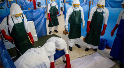Health care workers learn how to properly dispose of the remains of a simulated patient who died from Ebola in Buchanan City, Nov. 21, 2014. Joint Forces Command – United Assistance mobile training team trains local health care workers on how to properly manage an Ebola treatment unit. Operation United Assistance is a Department of Defense operation in Liberia to provide logistics, training and engineering support to U.S. Agency for International Development-led efforts to contain the Ebola virus outbreak in western Africa. (U.S. Army photo by Staff Sgt. Terrance D. Rhodes/RELEASED)