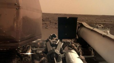 Take a look at the photos NASA's InSight sent back after a successful landing on Mars